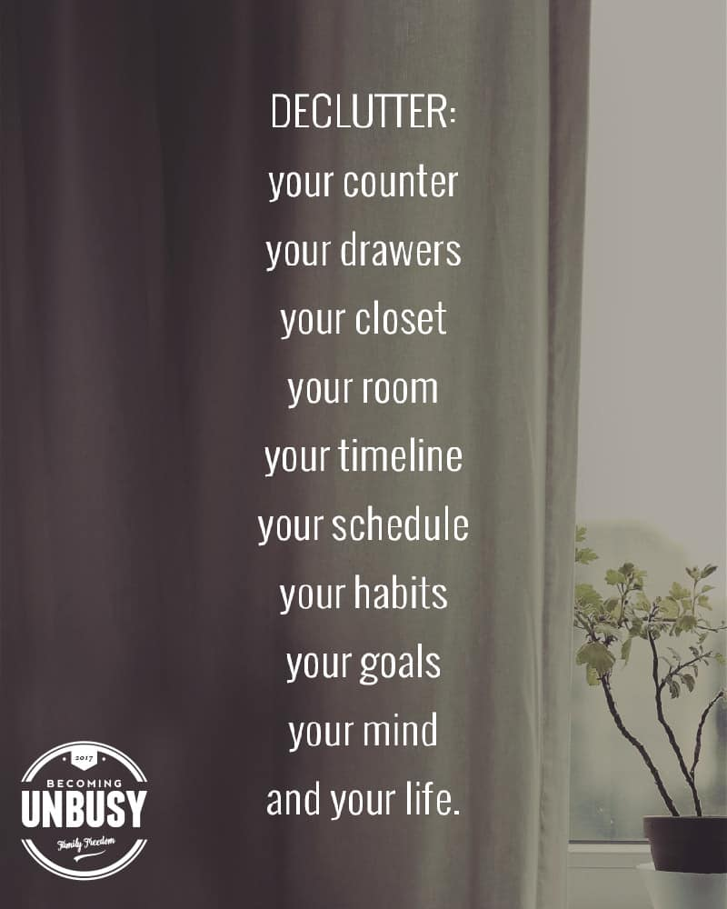 """A window with the quote """"Declutter Your Counter, Your Drawers, Your Closet, Your Room, Your Timeline, Your Schedule, Your Habits, Your Goals, Your Mind, Your Life"""""""