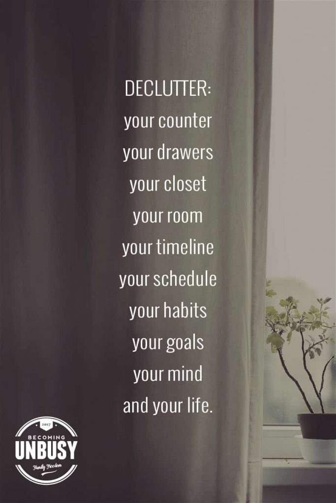 """A curtain half covering a window with the following text, """"Declutter your counter, your drawers, your closet, your room, your timeline, your schedule, your habits, your goals, your mind, and your life."""""""