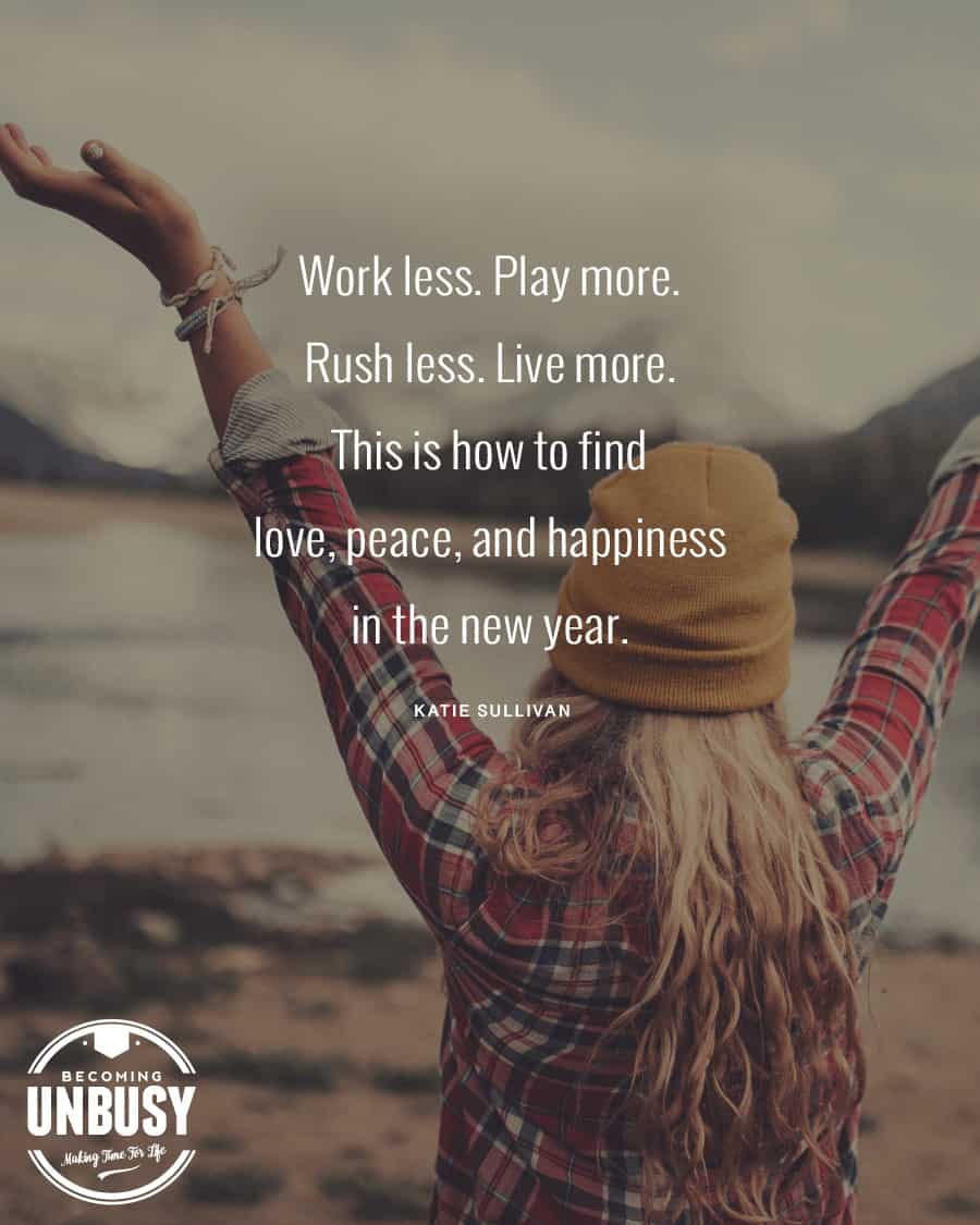 Woman standing with her arms wide open in front of mountains with this quote over the photo: Work less. Play more. Rush less. Live more.