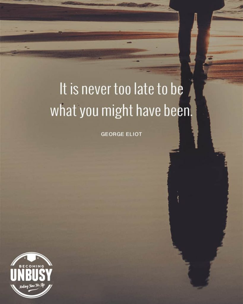"""A woman looking at her reflection in the water with a quote about how to start over overtop the image reading, """"It's never too late to be might what you might have been."""""""
