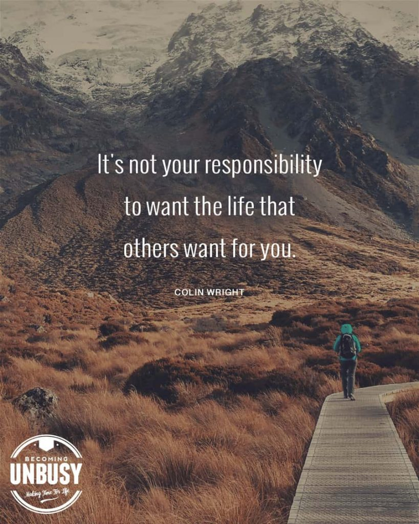 """A woman walking on a wood path in the moutains with a quote about change written overtop reading, """"It is not your responsibility to want the life others want for you."""""""