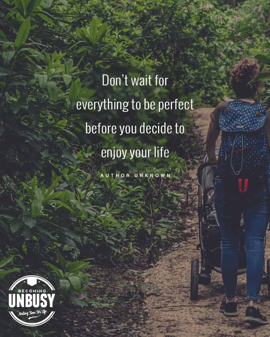 """Mom pushing stroller in nature with quote """"Don't wait for everything to be perfect before you decide to enjoy your life."""""""