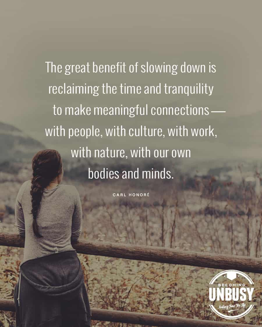 """A woman leaning on a fence with this slow living quote """"The great benefit of slowing down is reclaiming the time and tranquility to make meaningful connections--with people, with culture, with work, with nature, with our own bodies and minds."""